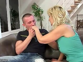Granny fucking with her young lover on the couch