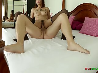 Bareback sex with a young tattooed Thai bar girl
