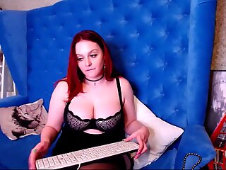 Busty camwhore licks nipple and plays with pussy