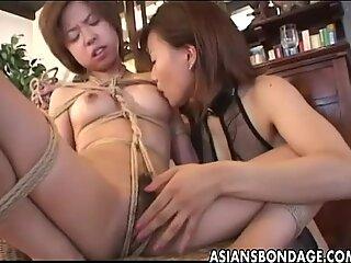 Tantalizing mistress fingers her cute slavegirl