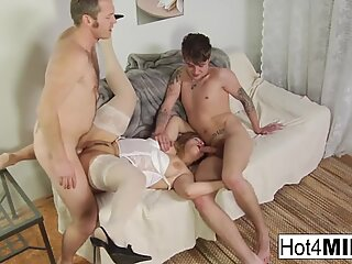 Busty MILF takes two cocks