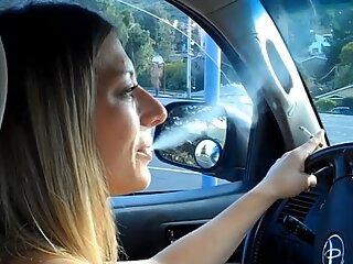 expert mature smokes in car.