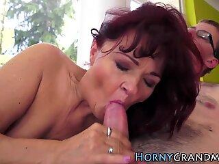 Mature granny sucks cock