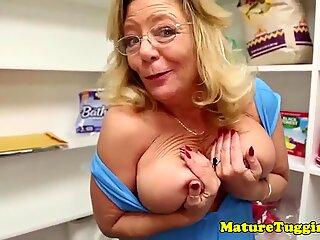 Busty mature jerking hard dick